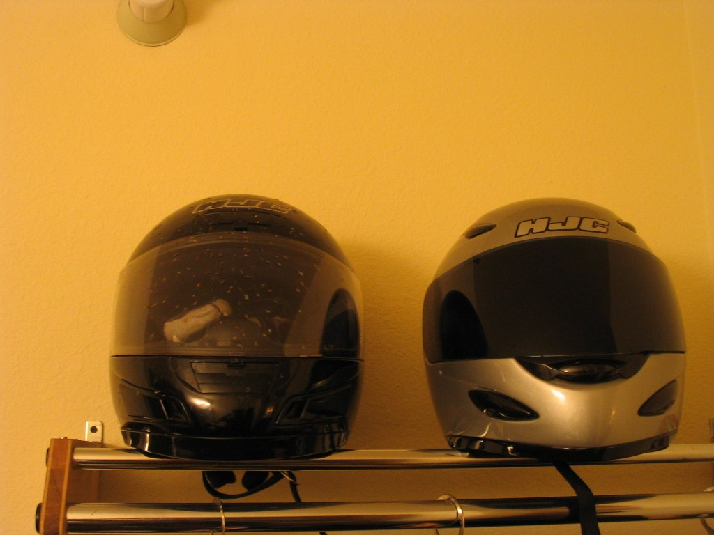 One rider keeps his helmet clean, the other doesn't.